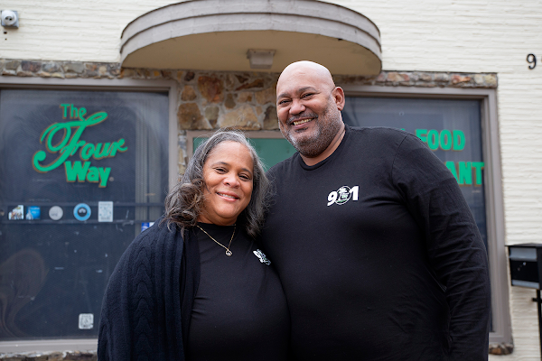 Patrice Bates Thompson, owner of The Four Way Restaurant, and her husband, Jerry Thompson, pose in front of the restaurant.