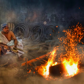 Men with fire by Indrawan Ekomurtomo - People Portraits of Men