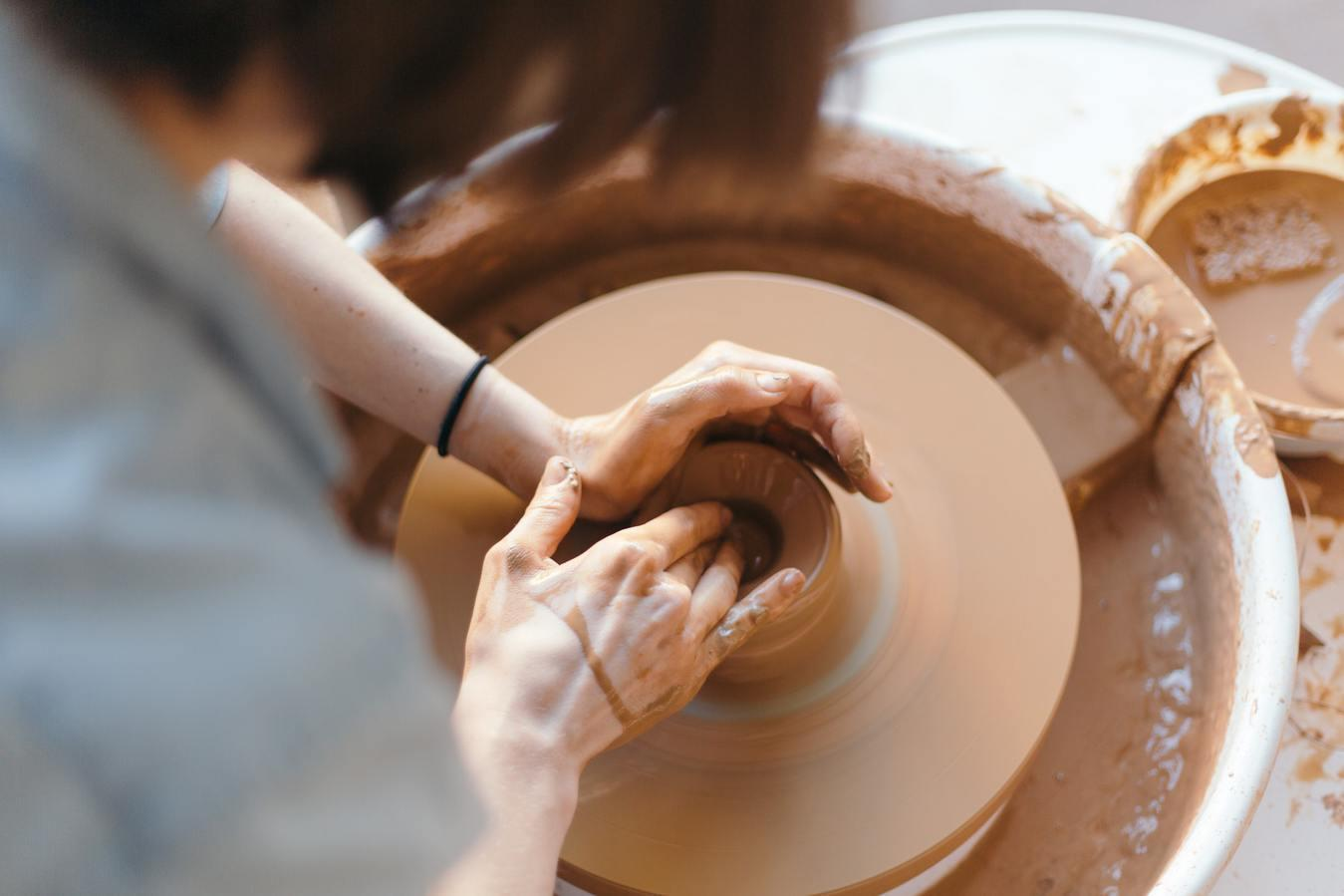 Handmade pottery and ceramics products being made by a person