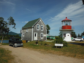 Photo: The new museum exhibiting information about the lights and lightkeepers of St. Pauls Island. The light is the old Southwest Light from St. Pauls Island. Other than the museum there is not much else. A few houses but no provisioning, fuel or restaurants in the village itself.
