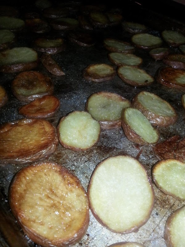 Whole baked potatoes (or sliced and oiled baked potatoes, they cook faster).  When cool enough...