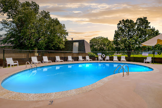 Bridge Creek Apartments sparkling community pool at dusk
