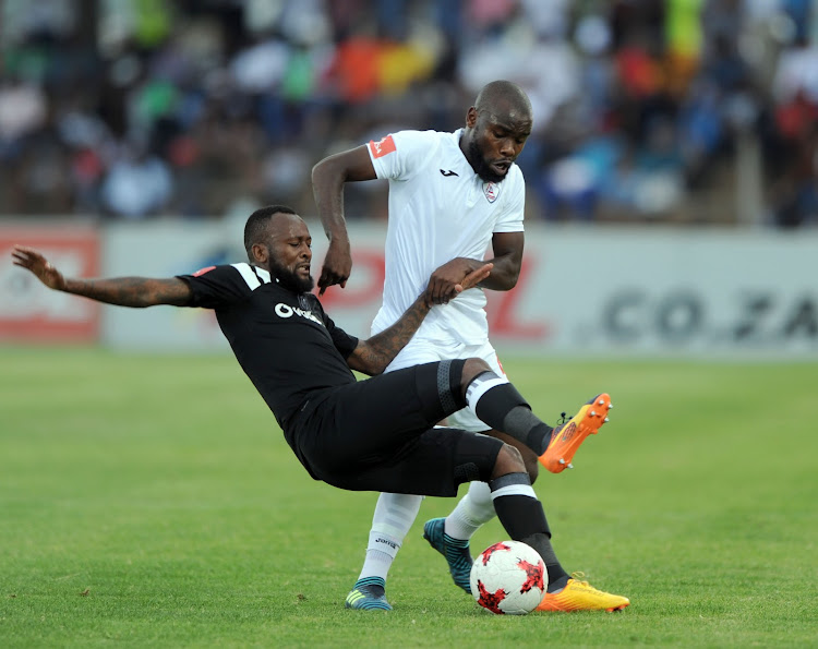 Mpho Makola of Orlando Pirates is challenged by Makhehleni Makhaula of Free State Stars players during the Absa Premiership match between Free State Stars and Orlando Pirates on 16 December 2017 at Goble Park Stadium.