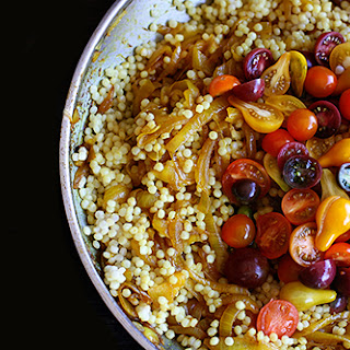 Recipe for Israeli Couscous with turmeric, caramelized onions, and tomatoes