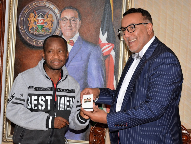 Tourism CS Najib Balala awards Patrick Kilonzo with Presidential award