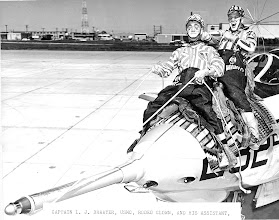 Photo: Capt. L.J. Draayer, USMC and his assistant, Ben W. Allen AC2, take a ride on a wild bronc, better known as an F9F-8B, in preparation for the Navy Relief Rodeo.