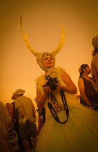 Photo: Know this Russian Photographer?  At Burning Man, you just end up taking photos of hundreds of random people and you can't remember them all... she was Russian, and that's just about all I remember. She made the costume herself... I think I recall that she made the horns out of bedsheets and glue. This reminds me to never underestimate a Russian woman.  As for the details of the photo, this was ISO 1600, 14mm, 1.3 EV, f/3.5, and shutter at 1/400th of a second. I took this with an Olympus PEN camera.... it was my favorite camera in the desert... I used it so that my other Nikons would not get destroyed by the desert sand.  #SICInDatabase