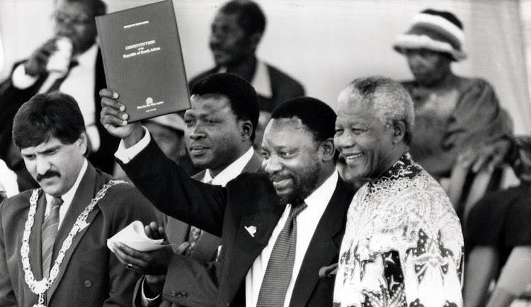 Cyril Ramaphosa holds up the newly signed South African Constitution, alongside Nelson Mandela, president at the time, in September 1996. Picture: ROBBIE BOTHA/BUSINESS DAY
