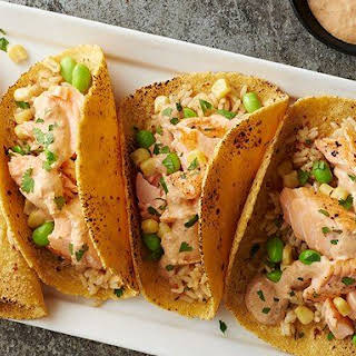 Salmon Fish Tacos with a Spicy Tomato Cream Sauce.