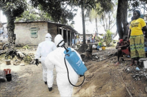 EPIDEMIC: Healthworkers at an ebola facility in Monrovia, Liberia PHOTO: ZOOM DOSSO/AFP