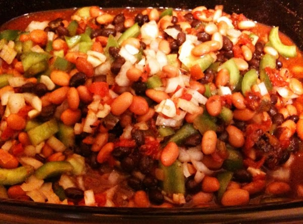 Combine beans, tomatoes with juice, bell pepper, Onion, broth, mole, cumin, chili powder,garlic and...