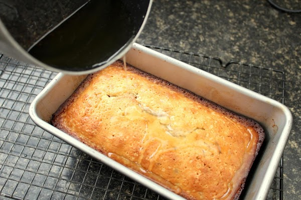 Remove warm breads from pan. Place back in pans and pour hot syrup over...