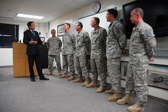 Photo: Governor Tim Pawlenty welcomes the Soldiers of the Minnesota National Guard's Detachment (Det) 39 after they returned from a year-long deployment in support of Operation Enduring Freedom. Their pilots and system operators directly supported United States and Coalition Forces with counterinsurgency operations in Afghanistan.  The unit conducted continuous combat flights throughout Afghanistan providing electro optic/infrared imagery with a modified Beechcraft King Air 300 C-12 Huron fixed-wing aircraft. Photo by Staff Sgt. Ben Houtkooper, www.MinnesotaNationalGuard.org