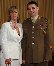Photo: Warrant Officer Class 1 Charlie McClure pictured with his wife at the award ceremony.A presentation of the parchment that is officially awarded to Warrant Officer Class 1 (WO1) ranks within the Royal Logistic Corps that gives them the official appointment to 'The Honourable and Ancient Appointment of Conductors'. The parchments were presented by Major General MD Wood CBE.