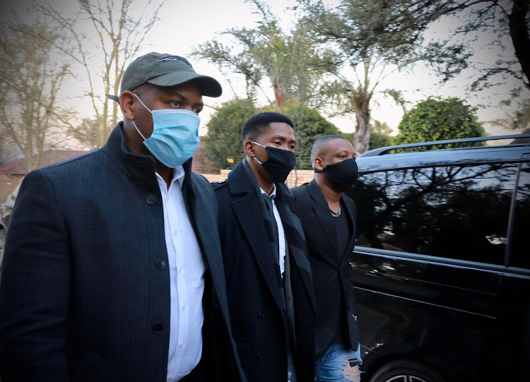 Ndaba Mandela, centre, is seen arriving at the funeral of Zindzi Mandela who died on Monday due to a Covid-19 related illness.