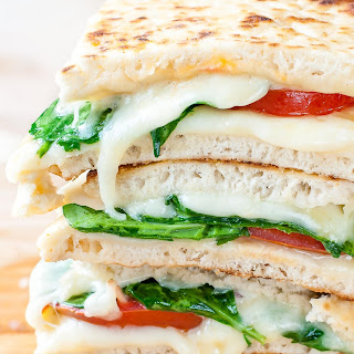 SPINACH AND TOMATO GRILLED CHEESE PITAS.