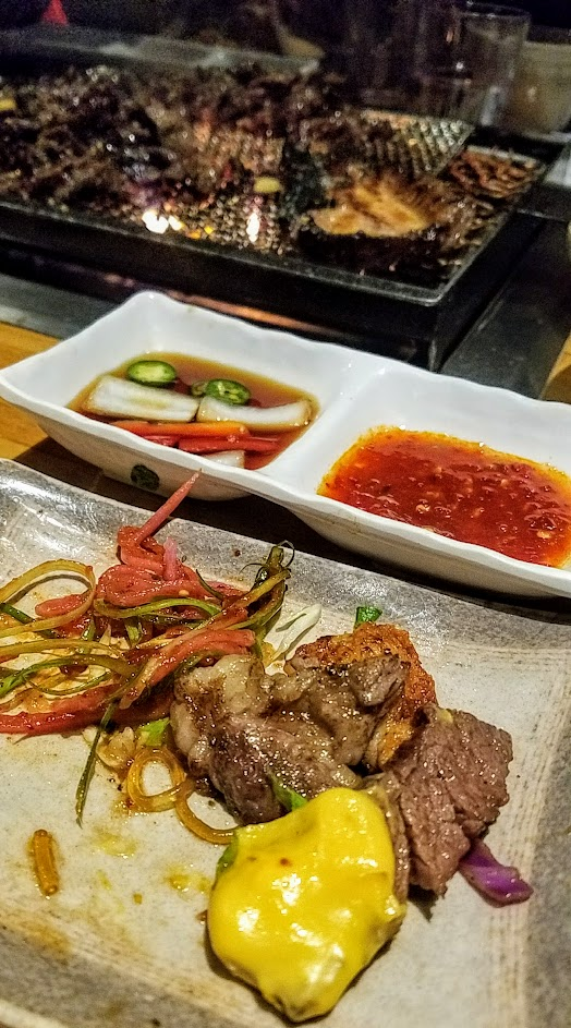 Korean BBQ at Quarters, named for how each of the raw meat tapas you order to cook on the grill are 1/4 pound and if you order 5 of them Quarters provides complimentary vegetable skewer, cheese fondue for dipping meat, egg soup, and kimchee or soy bean stew. Located in Koreatown, LA