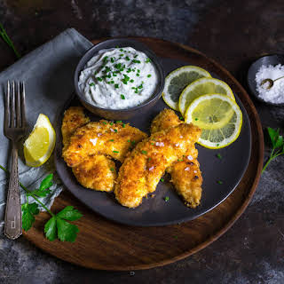 Crispy Oven-Fried Chicken Tenders with Garlic-Herb Yogurt Dip.
