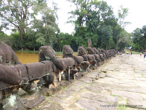 Photo: Crossing the moat to Preah Khan. The heads are a more recent loss.