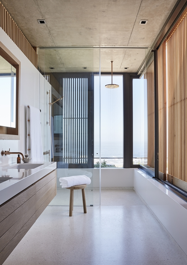 The main bathroom features a shower with a view.