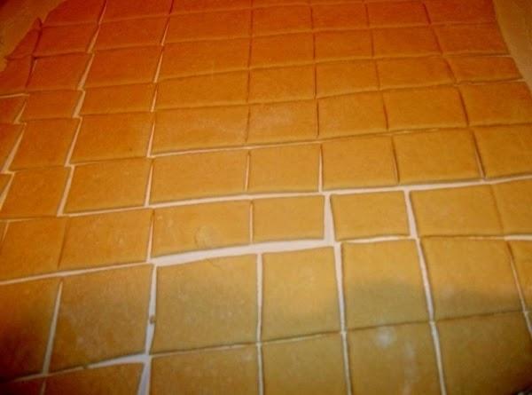 Heavily flour a work surface. ( I cut dough into fourths.)  Roll the...