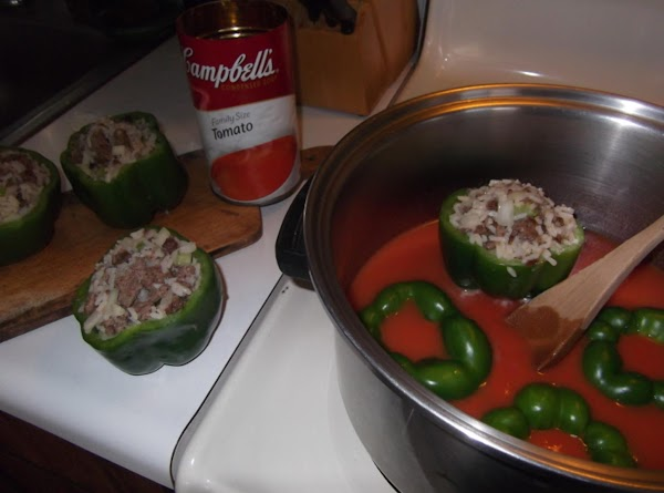In large pot combine tomato soup and water. HERE COMES THE COOLEST PART: Place pepper tops...