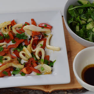 Stir-Fried Salt & Pepper Squid with Red Peppers & Onions.