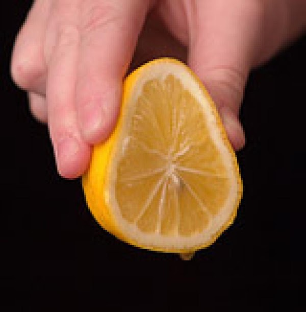 Not adding water yet, slice lemon in halves and gently squeeze juice of one...