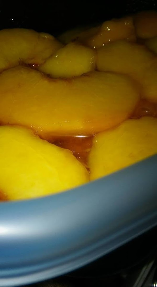 Divide the peaches and liquid into freezer containers.