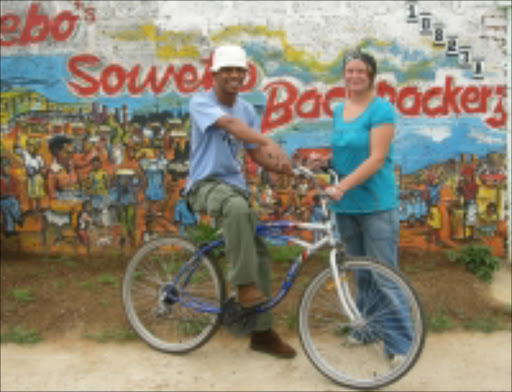 Riding HIGH: Lebohang Malepa, winner of the Tourism Business Council of South Africa award for excellence and innovation, and his Swedish fiancée Maria Westlund, are the owners of Lebo's Soweto Backpackers in Orlando West. Pic: Munyadziwa Nemutudi. 23/11/2007. © Sowetan  23/11/2007/winner of the Tourism Business Counci South Africa award for Excellence and innovation 2007  Mr Lebohang Malepa and his partner Mrs Maria Westlund from Swedan are the  Owners of Lebo's Soweto Backpackers PHOTO MUNYADZIWA NEMUTUDI