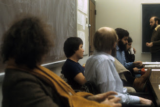 Photo: l to r: Jeff Berryman (UBC), ?, Dennis O'Reilly, ?, Jeff Ogden (UM), Bob Husak (Merit), Denis Russell, 3rd floor conference room, University of Michigan Computing Center, c. 1982