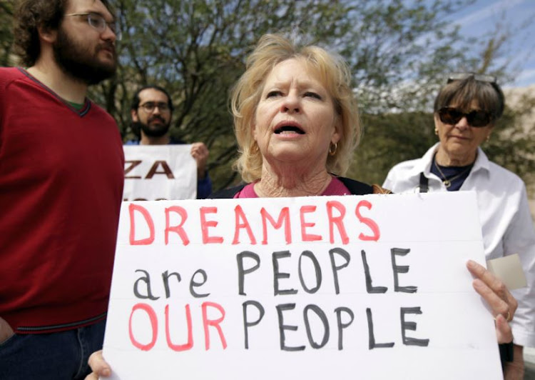 Members of the Border Network for Human Rights and Borders Dreamers and Youth Alliance (BDYA) protest outside a US Federal Courthouse to demand that Congress pass a Clean Dream Act in El Paso, Texas, US March 5, 2018.