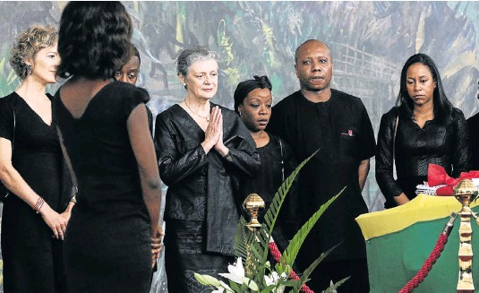 Kofi Annan's widow, Nane Maria, prays in front her husband's coffin at his state funeral in Accra, Ghana