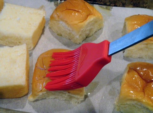 Preheat broiler.  Brush cut sides of roll tops lightly with oil. Arrange all...
