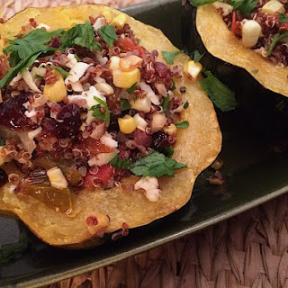 Roasted Acorn Squash Stuffed with Vegetable Quinoa.