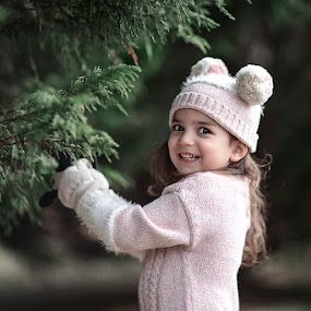 Winter Bear by A. Caracciolo - Babies & Children Child Portraits ( child, sweater, winter, girl, tree, gloves, cute, toddler, evergreen, outside, hat )