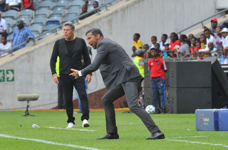 Orlando Pirates coach Josef Zinnbauer (R) reacts alongside his Black Leopards counterpart Luc Eymael.