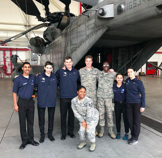 Det 009 cadets and TSgt Hunt pose in front of a Marine CH-53 Super Stallion