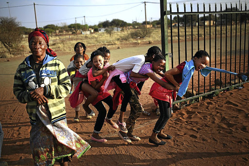 Mariana Chibia and children in Platfontein, Northern Cape. The community consists of two San tribes