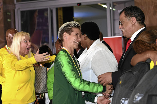 Banyana Banyana captain Janine van Wyk is welcomed by Safa president Danny Jordaan at OR Tambo International Airport in Johannesburg. The team jetted in from Ghana where they lost to Nigeria in the AWC final.