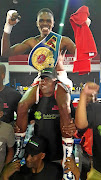 Ayanda Nkosi is carried aloft  after he was crowned the WBF champion last month.