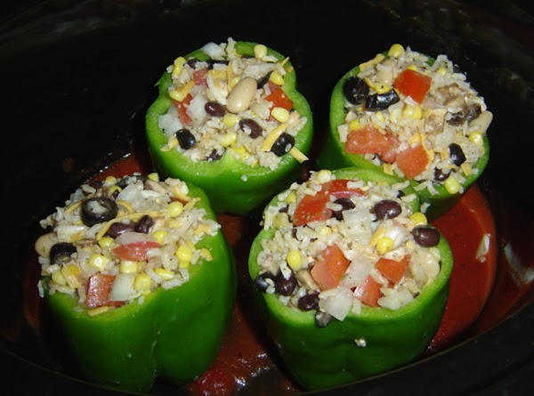 In a large bowl, combine rice, tomatoes, corn, onion, beans, Monterey Jack cheese, olives,...
