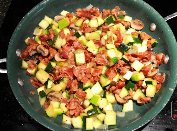 Add the cooked bacon, tomatoes and the parmesan cheese and stir to combine. Season...