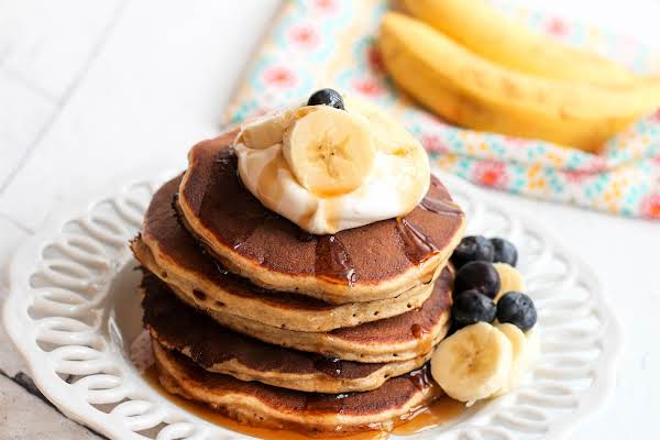 A Stack Of Whole Wheat Protein Banana Pancakes.