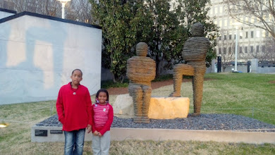 Photo: Kids outside with statues at the Frist Center