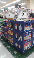 """Photo: Football Game Time displays are all through Walmart with the football field stickers on the floor and pallets of chips, sodas, and """"kick off"""" signage."""