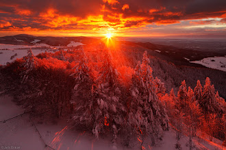 Photo: A spectacular winter sunset over the Black Forest and the plains around Freiburg far below - December.