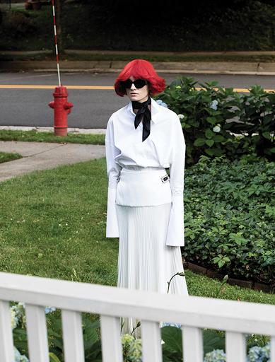 ALEXANDRE VAUTHIER ivory silk satin pleated long skirt, white poplin shirt, and silk scarf; ALAÏA sunglasses