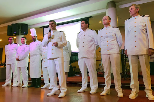 capt-pinto-and-wind-surf-crew.jpg - Wind Surf Capt. Pedro Pinto with a few of his executive officers greet the ship's guests.