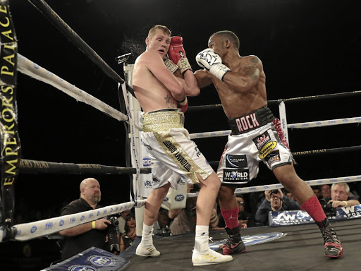 Thabiso Mchunu throws a right hook at Thomas Oosthuizen during their ABU title clash at Emperors Palace that Oosthuizen won. Their rematch is on December 8. / Nick Lourens